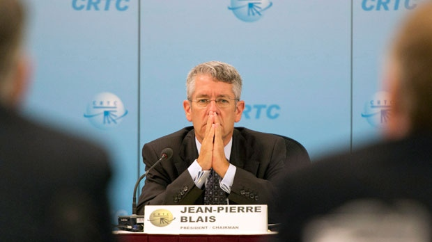 Chairman Jean-Pierre Blais listens to presenters at the Canadian Radio and Television Commission hearings on the Bell-Astral merger Wednesday, September 12, 2012 in Montreal. (The Canadian Press/Ryan Remiorz)