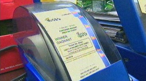 A Lotto Max ticket is checked for a prize at a store in Toronto.