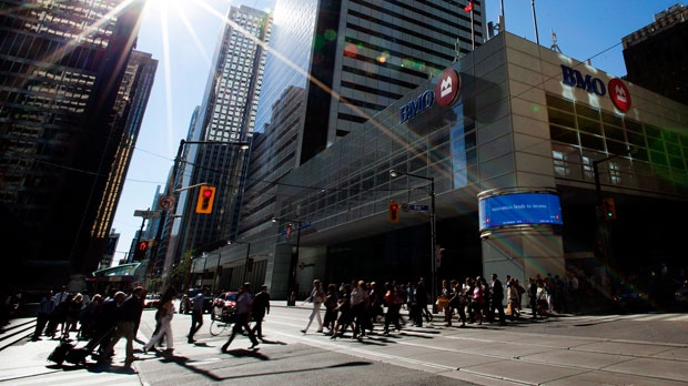 People pass by the Bank of Montreal in Toronto on Tuesday, Aug. 28, 2012. (The Canadian Press/Michelle Siu)