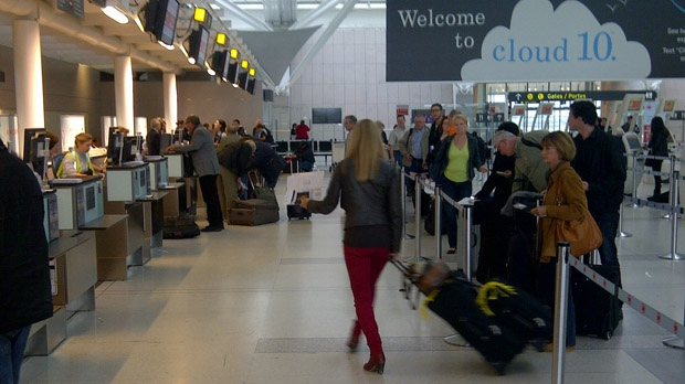 People check in at a departures desk at Pearson International Airport on Monday, Oct. 29, 2012. (CP24/George Lagogianes)