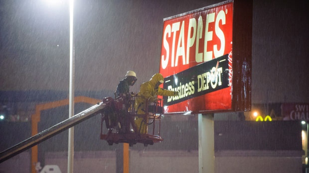 Sandy, storm damage, woman killed, Staples sign
