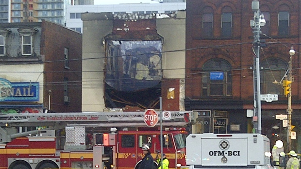 A three-alarm fire destroyed a commercial and residential building on Queen Street West, near Peter Street, on Tuesday, Oct. 30, 2012. (CP24/George Lagogianes)