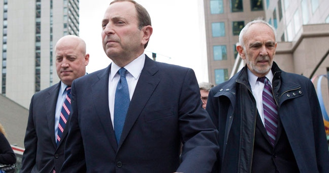 NHL Commissioner Gary Bettman, left, leaves the NHLPA offices with Assistant Commissioner Bill Daly (left) and NHL lawyer Bob Betterman following collective bargaining in Toronto on Thursday, Oct. 18, 2012. (Chris Young / THE CANADIAN PRESS)