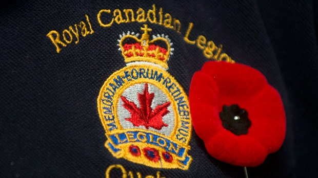 Norman Shelton, 1st vice-president of the Quebec branch of the Royal Canadian Legion wears a poppy on his shirt during an interview in Montreal on Friday, Nov. 2, 2012, where he spoke about the controversy surrounding Quebec premier Pauline Marois' choice to wear a Fleur de Lys on her poppy. (The Canadian Press/Graham Hughes)