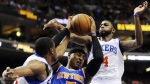 New York Knicks' Carmelo Anthony (7) drives between Philadelphia 76ers' Thaddeus Young (21) and Dorell Wright (4) in the first half of an NBA basketball game on Monday, Nov. 5, 2012, in Philadelphia. (AP Photo/Michael Perez)