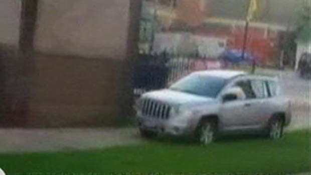 This screen grab shows a vehicle driving around a Cleveland school bus. The woman who was driving the vehicle was ordered to stand at an intersection wearing a sign warning about idiots.