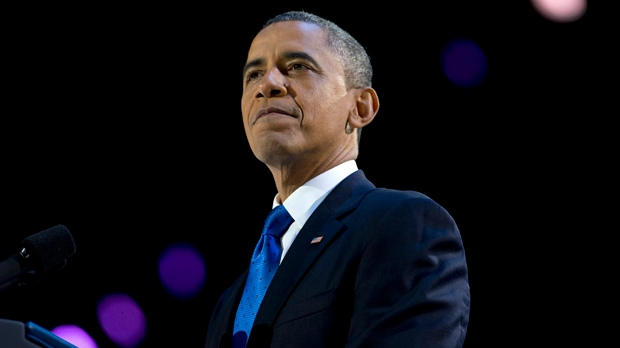 President Barack Obama pauses as he speaks at the election night party at McCormick Place in Chicago on Wednesday, Nov. 7, 2012. (AP Photo/Carolyn Kaster)