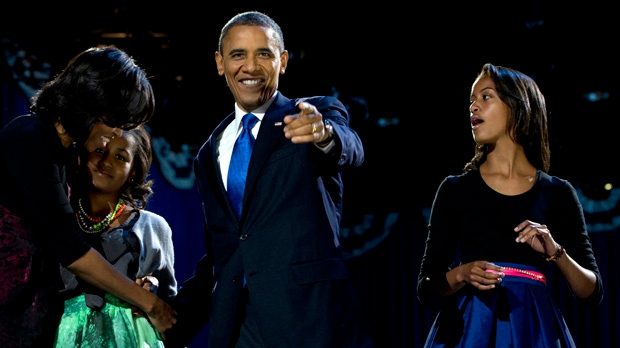President Barack Obama, accompanied by first last Michelle Obama and daughters Malia and Sasha, arrive at the election night party in Chicago early Wednesday, Nov. 7, 2012. (AP Photo/Carolyn Kaster)