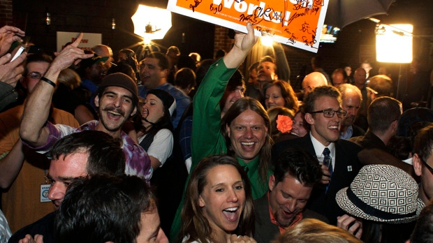 People attending an Amendment 64 watch party in a bar celebrate after a local television station announced the marijuana amendment's passage in Denver, Colo., on Tuesday, Nov. 6, 2012. (AP Photo/Brennan Linsley)