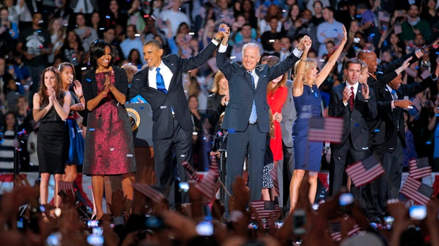 President Barack Obama and wife Michelle hold hands with Vice-President Joe Biden and his wife Jill following Obama's victory speech to supporters in Chicago early Wednesday, Nov. 7 2012. (AP Photo/Jerome Delay)