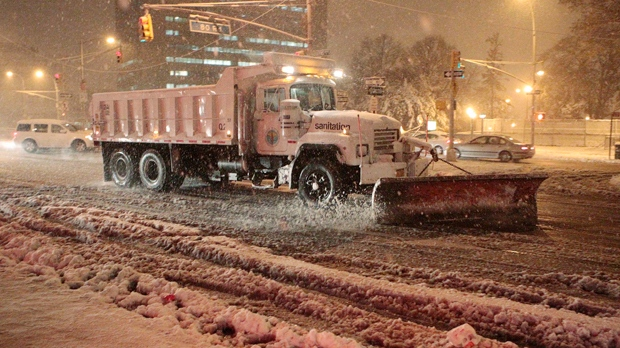 Sanitation workers shovel snow from Queens Boulevard during a storm in New York on Wednesday, Nov. 7, 2012. (AP Photo/Frank Franklin II)