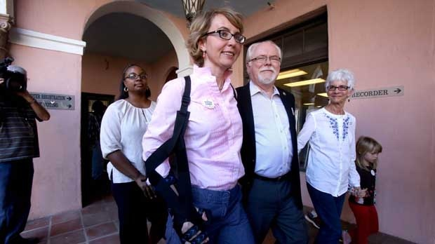 Former representative Gabrielle Giffords and Rep. Ron Barber (D-Ariz.), Demcratic candidate for Congresss, Arizona District 2, leave the the Pima County Recorder's Office in Tucson, Ariz., after turning in their early ballots on Monday, Nov. 5, 2012. (AP Photo/Arizona Daily Star, A.E. Araiza)