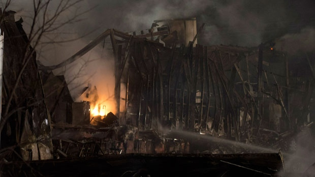 Fire burns at the Neptune Technologies & Bioressources plant in Sherbrooke, Que., on Thursday, Nov. 8, 2012 following a large explosion. (The Canadian Press/Graham Hughes)