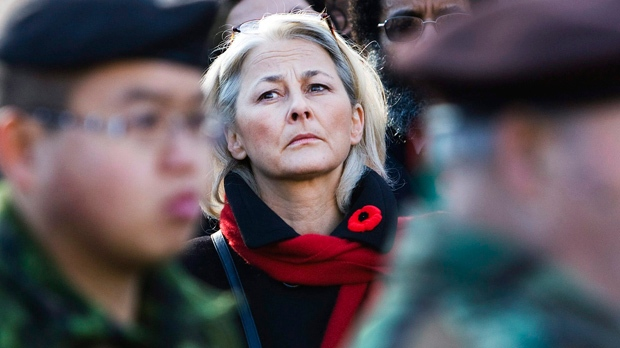 Members of the public stand during a moment of silence during a Remembrance Day ceremony at the Queen's Park Veteran's Memorial in Toronto on Thursday, Nov. 11, 2010. (The Canadian Press/Nathan Denette)