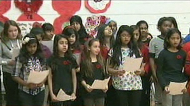 Students at D.A. Morrison Middle School sing a song during a Remembrance Day service Friday, Nov. 9, 2012.