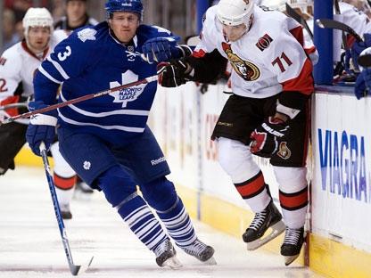516ebc63174 Toronto Maple Leafs defenceman Dion Phaneuf (3) rides Ottawa Senators left  winger Nick Foligno