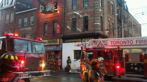 Firefighters at the scene of a two-alarm blaze on Queen Street West, at Cameron Street, on Monday, Nov. 12, 2012. (Cam Woolley/CP24)