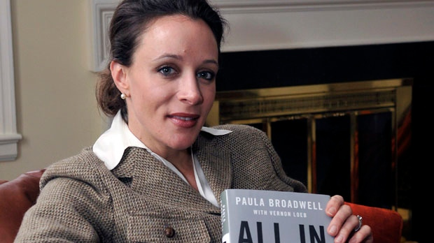"In this Jan. 15, 2012, photo, Paula Broadwell, author of the David Petraeus biography ""All In,"" poses for photos in Charlotte, N.C. (AP Photo/The Charlotte Observer, T. Ortega Gaines)"