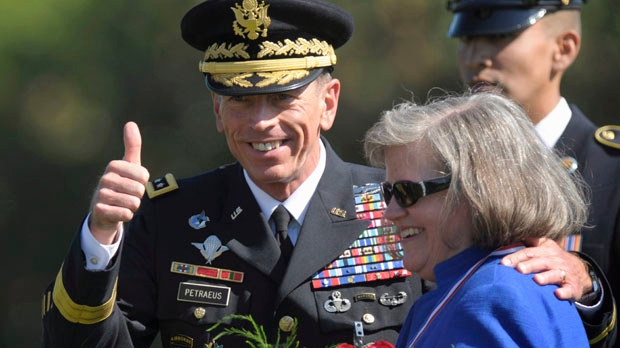 Former Commander of International Security Assistance Force and U.S. Forces-Afghanistan Gen. Davis Petraeus, standing with his wife Holly, participates in an armed forces farewell tribute and retirement ceremony at Joint Base Myer-Henderson Hall in Arlington, Va., on Aug. 31, 2011. (AP / Susan Walsh)