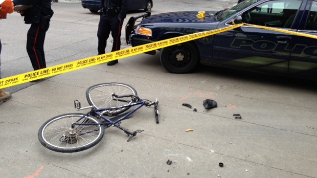 A woman was seriously injured when she was hit by a dump truck while cycling at Yonge and Gerrard streets on Tuesday, Nov. 13, 2012. (Keith Hanley/CP24)