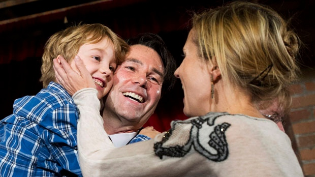 MPP Eric Hoskins, centre, announces his candidacy for leader of the Ontario Liberal Party with his wife Samantha Nutt and their seven-year-old son Rhys in Toronto on Tuesday, Nov. 13, 2012. (The Canadian Press/Nathan Denette)