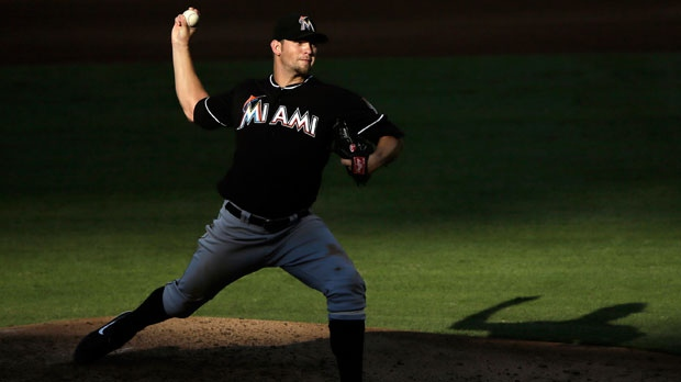 Miami Marlins' Josh Johnson pitches in the fourth inning of a baseball game against the Philadelphia Phillies in Philadelphia, Sept. 12, 2012. (AP / Matt Slocum)