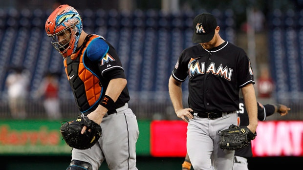 Miami Marlins catcher John Buck walks away from the mound after talking with relief pitcher Chad Gaudin during the 10th inning of a baseball game against the Washington Nationals at Nationals Park on Saturday, Sept. 8, 2012, in Washington. (AP Photo/Alex Brandon)