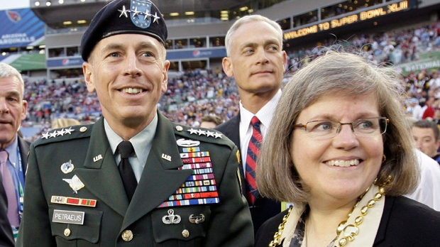 In this Feb. 1, 2009, file photo, Gen. David Petraeus stands with his wife Holly before the NFL Super Bowl XLIII football game between the Arizona Cardinals and Pittsburgh Steelers in Tampa, Fla. (AP Photo/David J. Phillip, File)