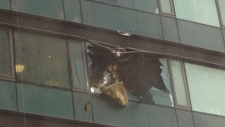 falling glass Trump Tower