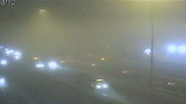 This screen grab from a traffic camera shows vehicles driving through fog early Tuesday, Nov. 20, 2012.