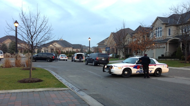Police investigate a home invasion on Treelawn Boulevard in Vaughan on Tuesday, Nov. 20, 2012. (Tom Stefanac/CP24)