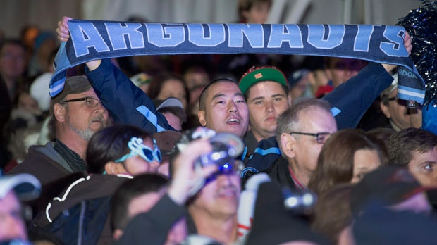 Toronto Argonauts fans cheer at a pep rally in Toronto on Tuesday, Nov. 20, 2012. (The Canadian Press/Frank Gunn)