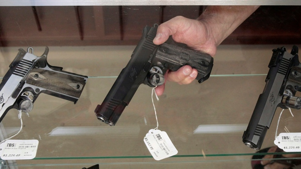 Gun store handguns on display