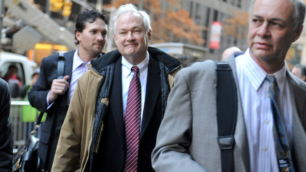 NHL Players' Association executive director Donald Fehr, centre, arrives for labour talks at the NHL's headquarters in New York alongside his brother, NHLPA counsel Steven Fehr, right, Wednesday, Nov. 21, 2012. (AP Photo/ Louis Lanzano)