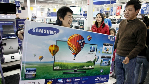 Customers shop for Black Friday discounts at a Best Buy store in Philadelphia on Friday Nov 23, 2012. (AP Photo/ Joseph Kaczmarek)