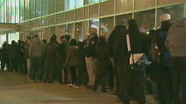 Black Friday shoppers line up outside the Best Buy at Eaton Centre in Toronto on Friday, Nov. 23, 2012.