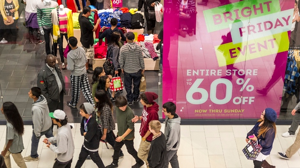 Young people shop early in the early morning hours at a GAP store at the Glendale Galleria mall in Glendale, Calif., on Friday, Nov. 23, 2012. (AP Photo/Damian Dovarganes)
