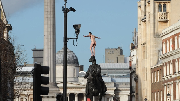 London Whitehall standoff naked man top statue