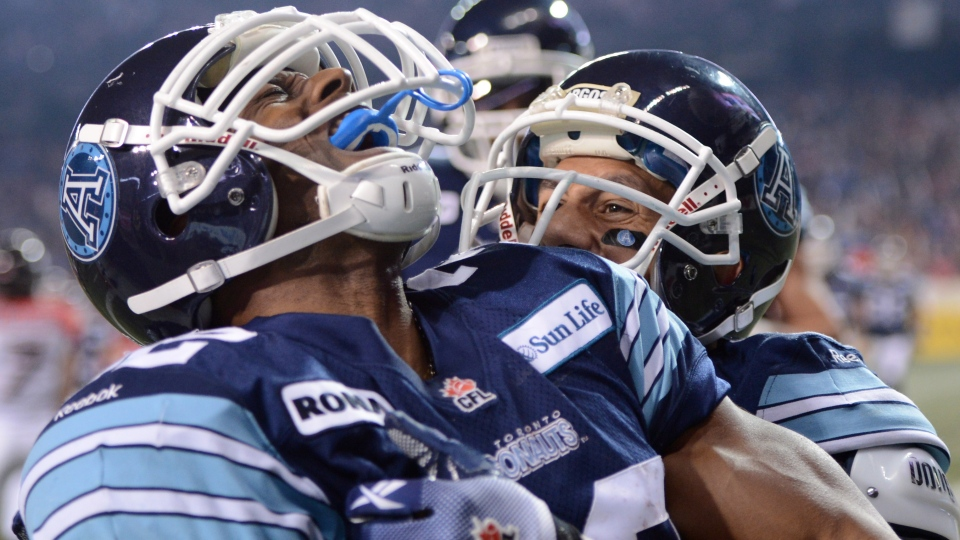 Toronto Argonauts running back Andre Durie celebrates his touchdown against the Calgary Stampeders with teammate Chad Owens during fourth quarter CFL Grey Cup action Sunday November 25, 2012 in Toronto. (Sean Kilpatrick/ THE CANADIAN PRESS)