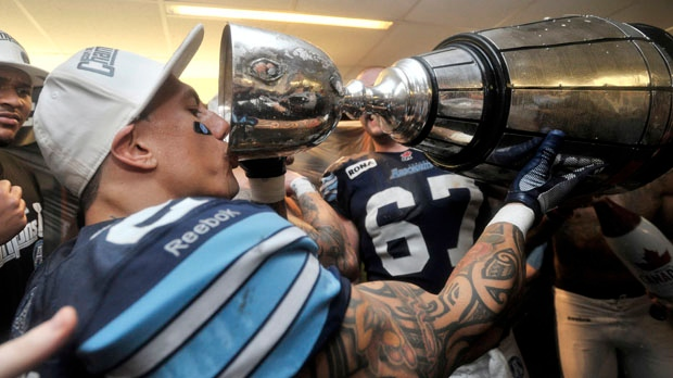 Toronto Argonauts slotback Chad Owens drinks from the Grey Cup as he celebrates the team's championship victory against the Calgary Stampeders on Sunday, Nov. 25, 2012, in Toronto. (The Canadian Press/Nathan Denette)