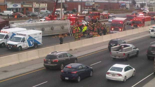 Gardiner, man trapped, accident, truck rollover