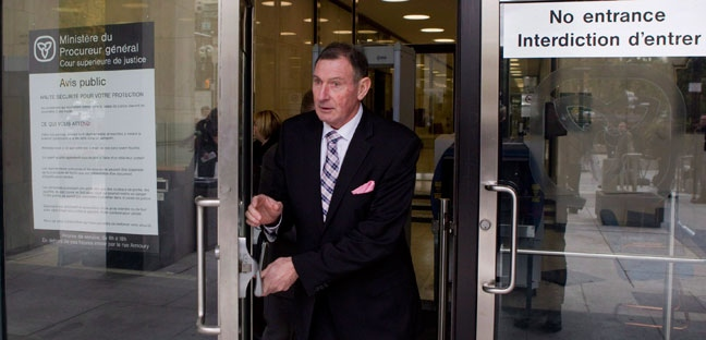 Ken Coran, president of the Ontario Secondary School Teachers' Federation, leaves the Ontario Superior Court of Justice with fellow union leaders, as they announce a legal challenge to Bill 115, in Toronto on Thursday, Oct. 11, 2012. (The Canadian Press/Chris Young)