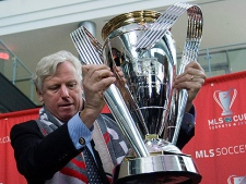 City of Toronto Mayor David Miller places the MLS Cup trophy on its stand to kick off MLS Cup 2010 festivities for Sunday's Major League Soccer championship game between FC Dallas and the Colorado Rapids in Toronto on Wednesday, November 17, 2010. (THE CANADIAN PRESS/Nathan Denette)