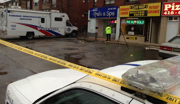Police are shown at the scene of a fatal shooting near Keele Street and Wilson Avenue Sunday morning. (Mathew Reid/CP24)
