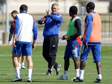 FC Dallas head coach Schellas Hyndman, center, instructs Marvin Chavez (18) of Honduras, Jeff Cunningham, right, of Jamaica and other members of his team during a morning soccer practice for the MLS Cup Wednesday, Nov. 17, 2010, in Frisco, Texas. (AP Photo/Tony Gutierrez)