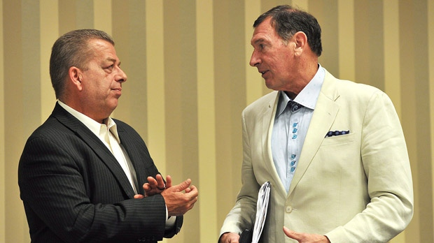 Sam Hammond, left, president of the Elementary Teachers' Federation of Ontario, speaks with Ken Coran, president of the Ontario Secondary School Teachers' Federation, after a press conference in Toronto on Thursday, Aug. 30, 2012. (The Canadian Press/Aaron Vincent Elkaim)