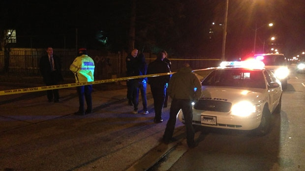 Toronto police are seen in this photo after multiple gunshots were fired on Islington Avenue, north of Dixon Road, on Tuesday, Dec. 4, 2012 (CP24/Tristan Phillips)