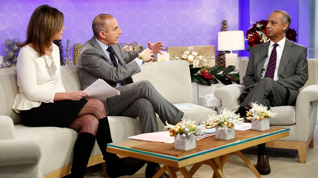 "This image released by NBC shows co-hosts Savannah Guthrie, left, and Matt Lauer, centre, during an interview with freelance photographer R. Umar Abbasi on NBC News' ""Today"" show, Wednesday, Dec. 5, 2012, in New York. (AP Photo/NBC, Peter Kramer)"