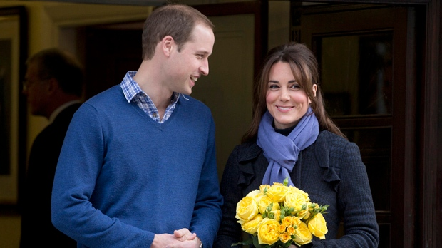 Britain's Prince William stand next to his wife Kate, the Duchess of Cambridge, as she leaves the King Edward VII hospital in central London, Thursday, Dec. 6, 2012. (AP Photo/Alastair Grant)