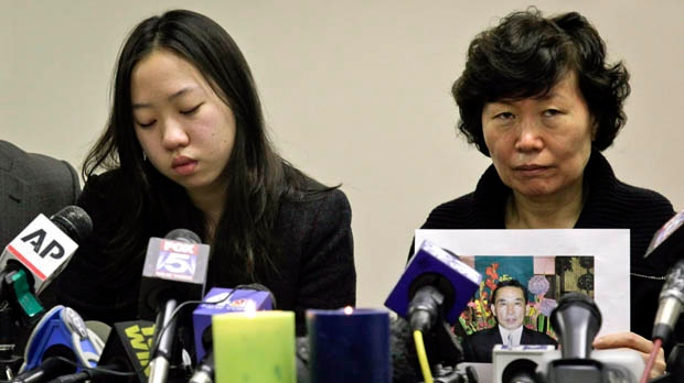 Serim Han, right, holds a picture of her husband Ki-Suck Han, as she sits next to their daughter Ashley Han, 20, during a news conference on Wednesday, Dec. 5, 2012, in New York. (AP Photo/Bebeto Matthews)